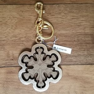 Coach Signature Spinning Snowflake Bag Charm